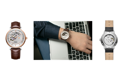 Wrist watch with brown strap and yin yang design.