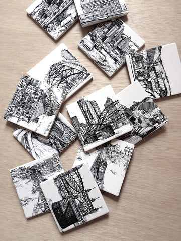 collection of coasters printed with different Pittsburgh architecture