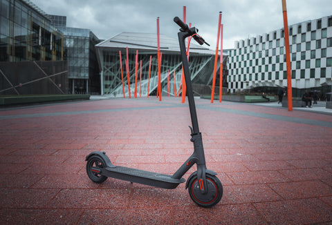 Xiaomi m365 electric scooter standing freely at the Docklands in Dublin.