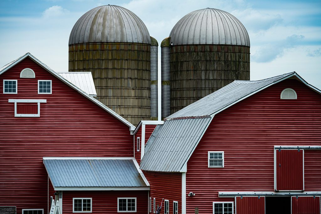 Red barns with silos and blue sky in Vermont
