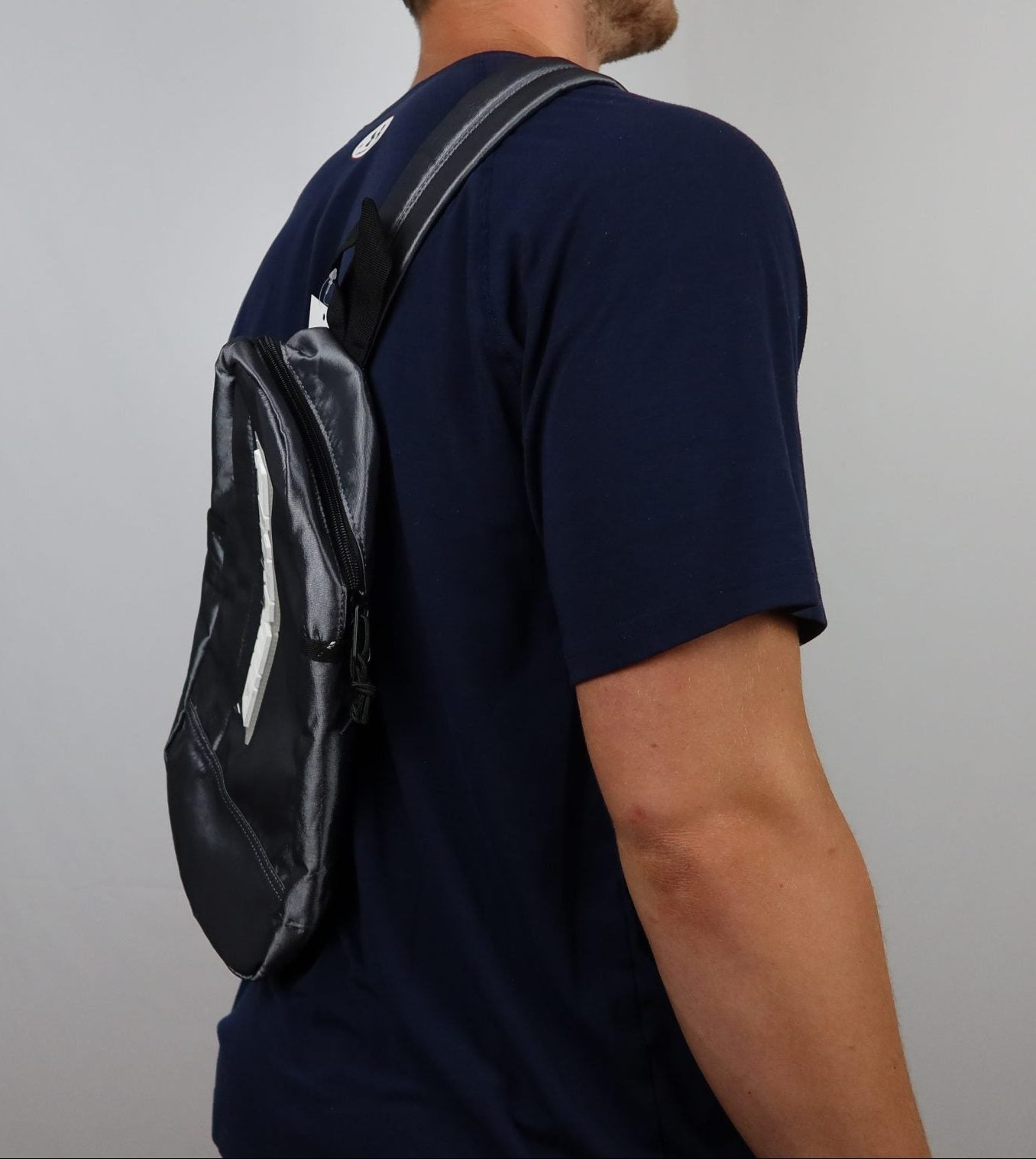 Black pyramid gray one strap bag