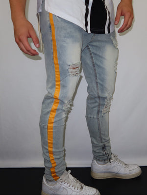 Light blue skinny jeans with Orange stripes