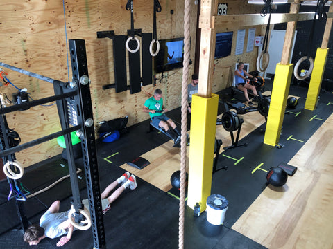 Athletes performing the Workout Of The Day (WOD) at SoWal CrossFit® in Santa Rosa Beach, FL
