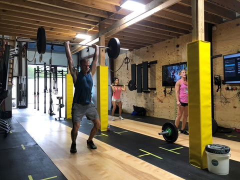 Head coach Matt Titus performing his favorite CrossFit® move, the thruster, at SoWal CrossFit in Santa Rosa Beach, FL.