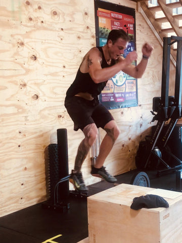 Head Coach Matt Titus performing a box jump at SoWal CrossFit® in Santa Rosa Beach, Florida