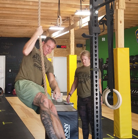 Head coach Matt Titus demonstrates the finer points of the rope climb for a SoWal CrossFit® personal training client.
