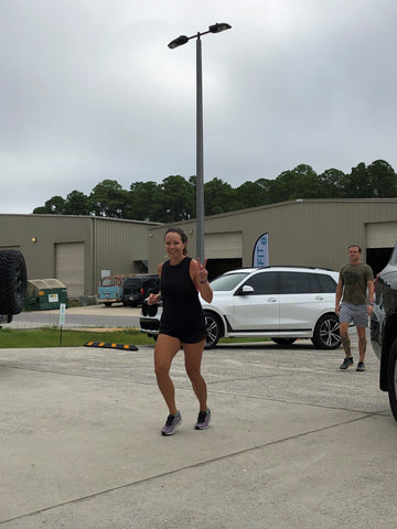SoWal CrossFit® athlete completing a run outside on the road