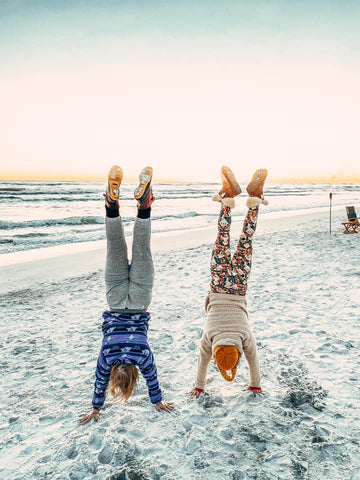 SoWal CrossFit® athletes performing handstands on the beach in Santa Rosa Beach Florida.