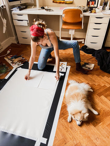 Artist Working in her Studio with her Dog