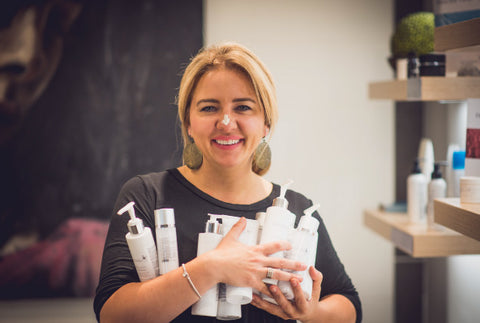 Ildiko Juhasz co-owner of revoderm holding products in her arms