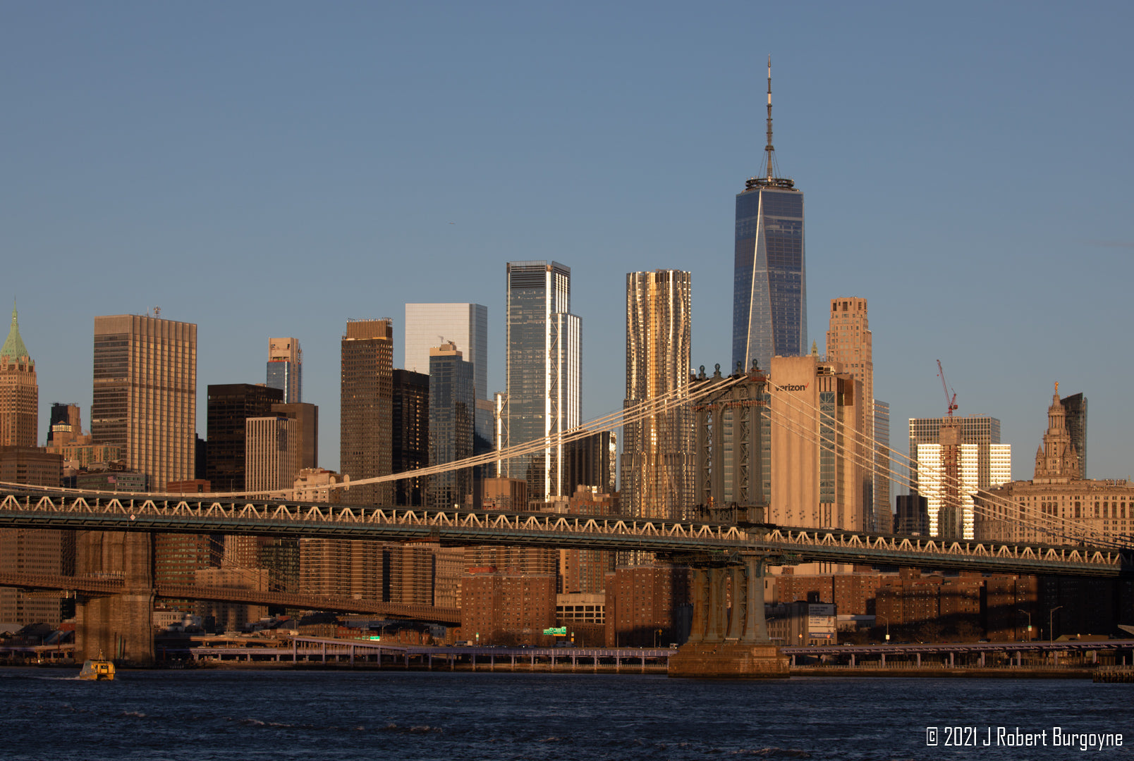 Image of Manhattan Bridge on the East River with skyscrapers in the background