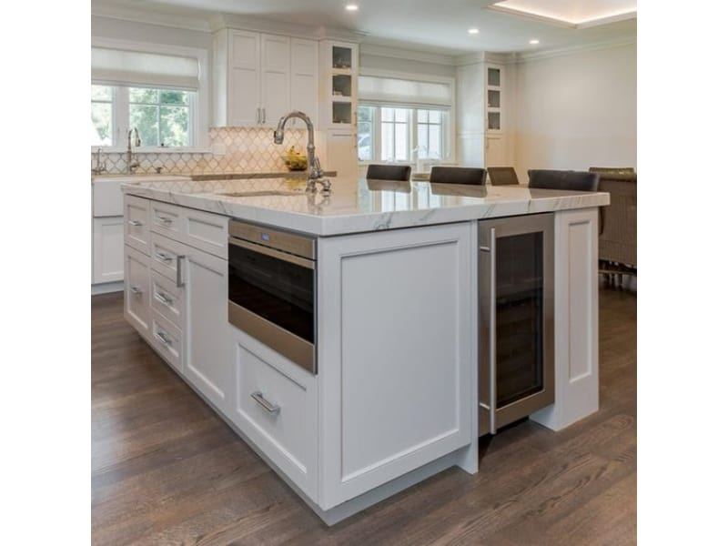 Built-In Microwave and Wine Bar in a Kitchen Island - Photo by Krista Abel