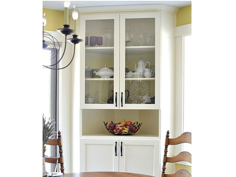 Incorporate a Corner China Cabinet in the Dining Area