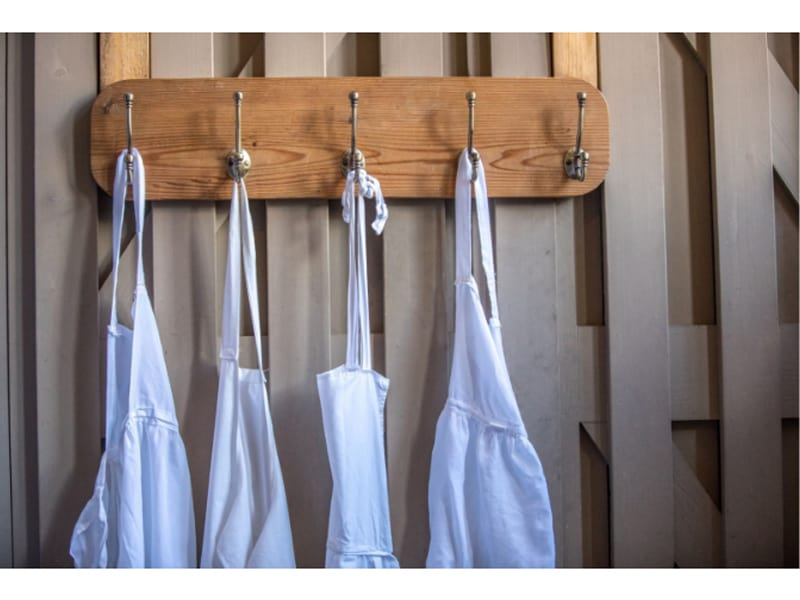 Cooks kitchen aprons hanging in a vintage setting