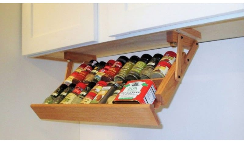 Use the Bottoms of Cabinets as Coffee Pods or Spice Racks