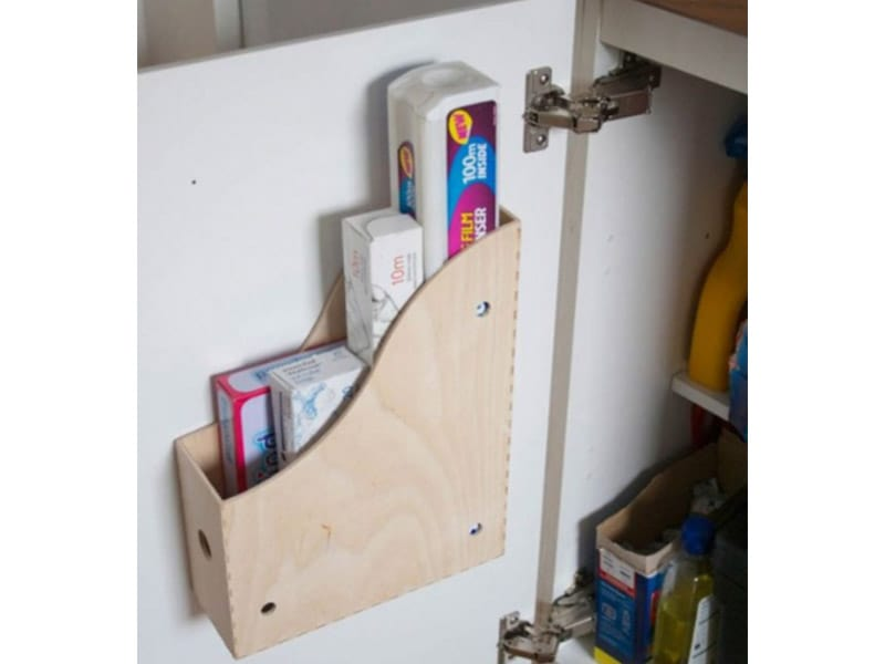 Use a Magazine Holder to Store Cleaning Supplies