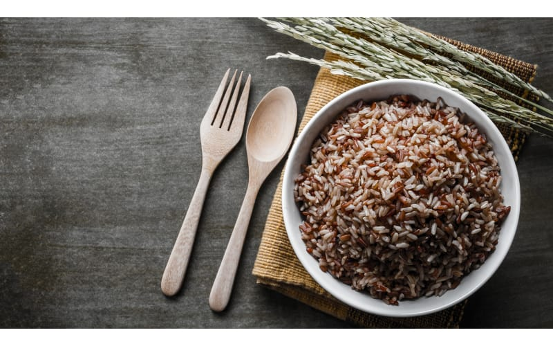 Brown Rice in a Bowl with Utensils