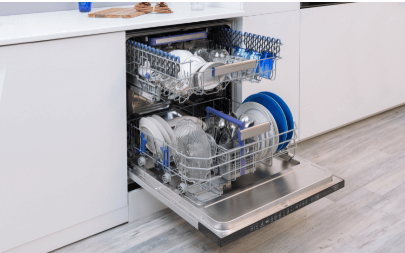 A dishwasher filled with plates and utensils