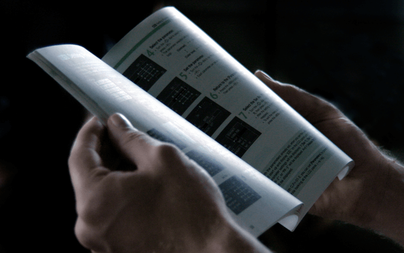 A person reading the instruction manual