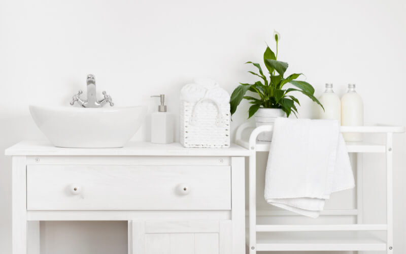 Compact bathroom interior with white vintage furniture