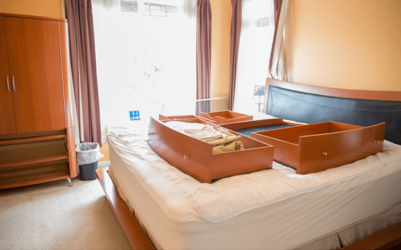 Drawers Splayed Out On The Bed For Reorganization