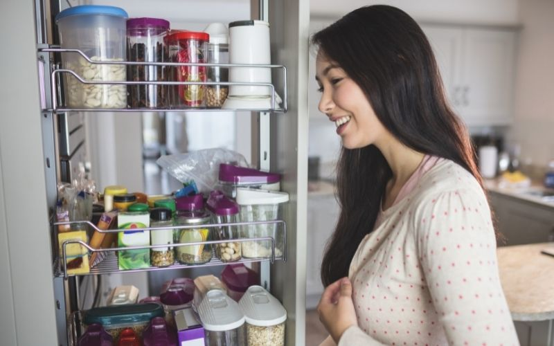 Woman looking at a cabinet organizer