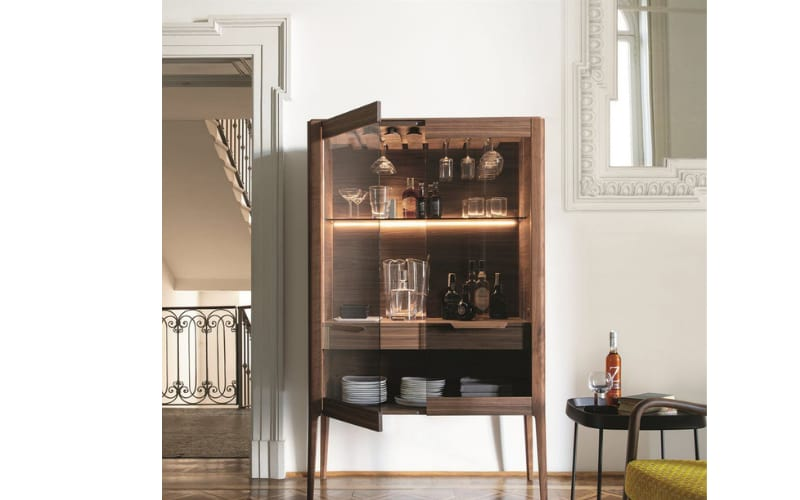 A Rustic and Modern Liquor Cabinet with a Glass Door - Image by Archi Expo