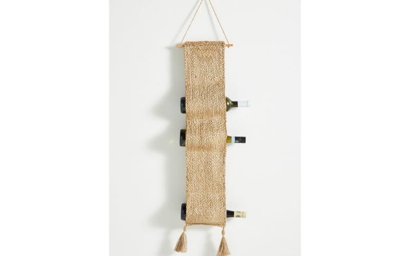 Dual-Purpose Hanging Tapestry and Wine Holder - Image by HGTV
