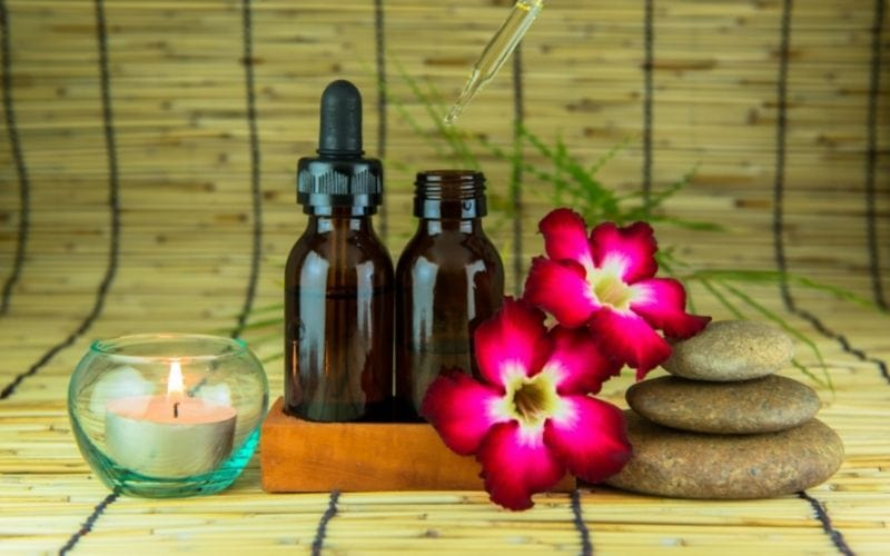 Essential oils with dropper and flower