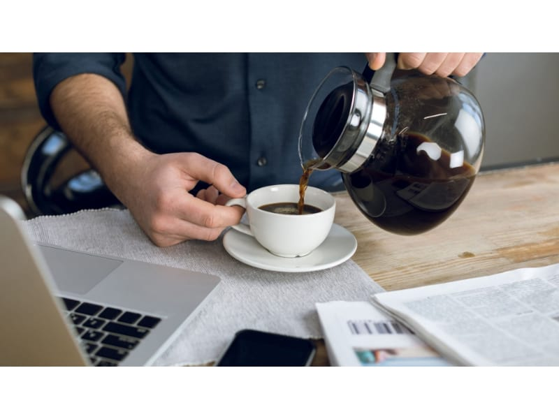 Man pouring coffee in a cup