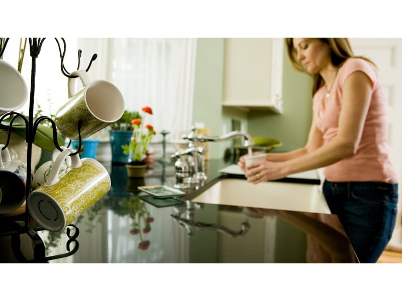 A mug holder tree by the kitchen sink