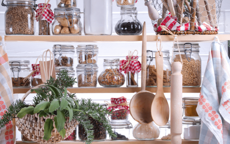 Open-shelved pantry with dry foods and a planter