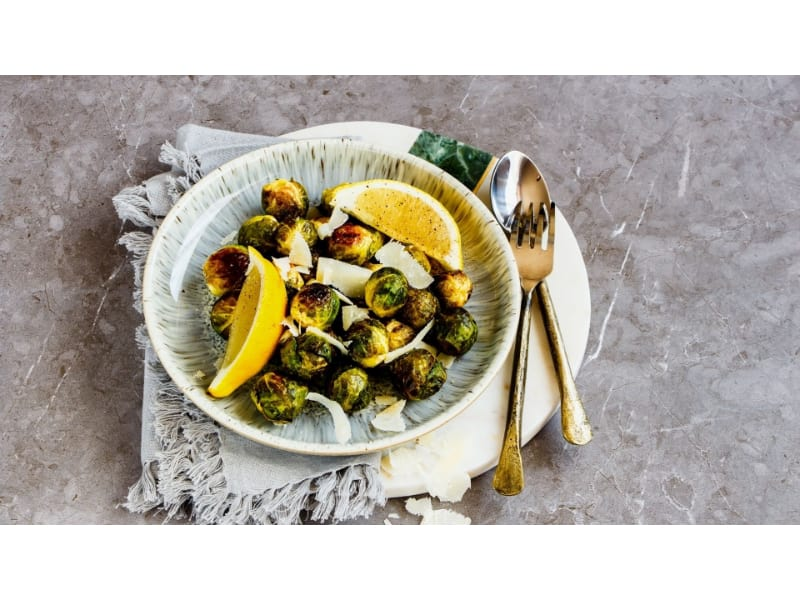 Parmesan Brussels Sprout Bites on a plate with utensils