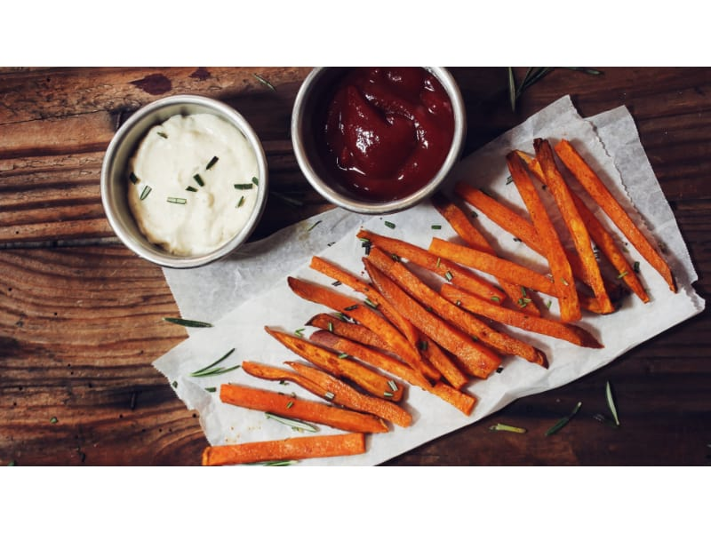 Sweet potato fries with mayo and ketchup on the side