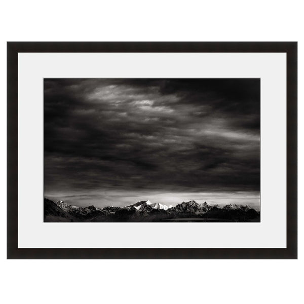 Image shown in Black Onyx frame with white mat. Mountains, Forest, Trees and Clouds in winter photographed by Vincent Versace.