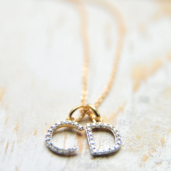 Dainty diamond initial jewelry in 14K gold. Mothers Day gift ideas for mothers, mama's and new moms.