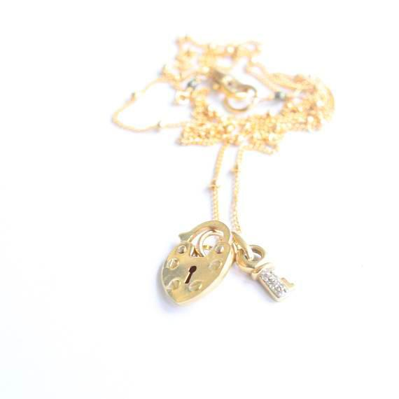 Gold and diamond heart and key necklace