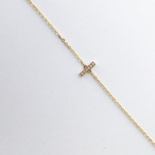 Diamond tick necklace