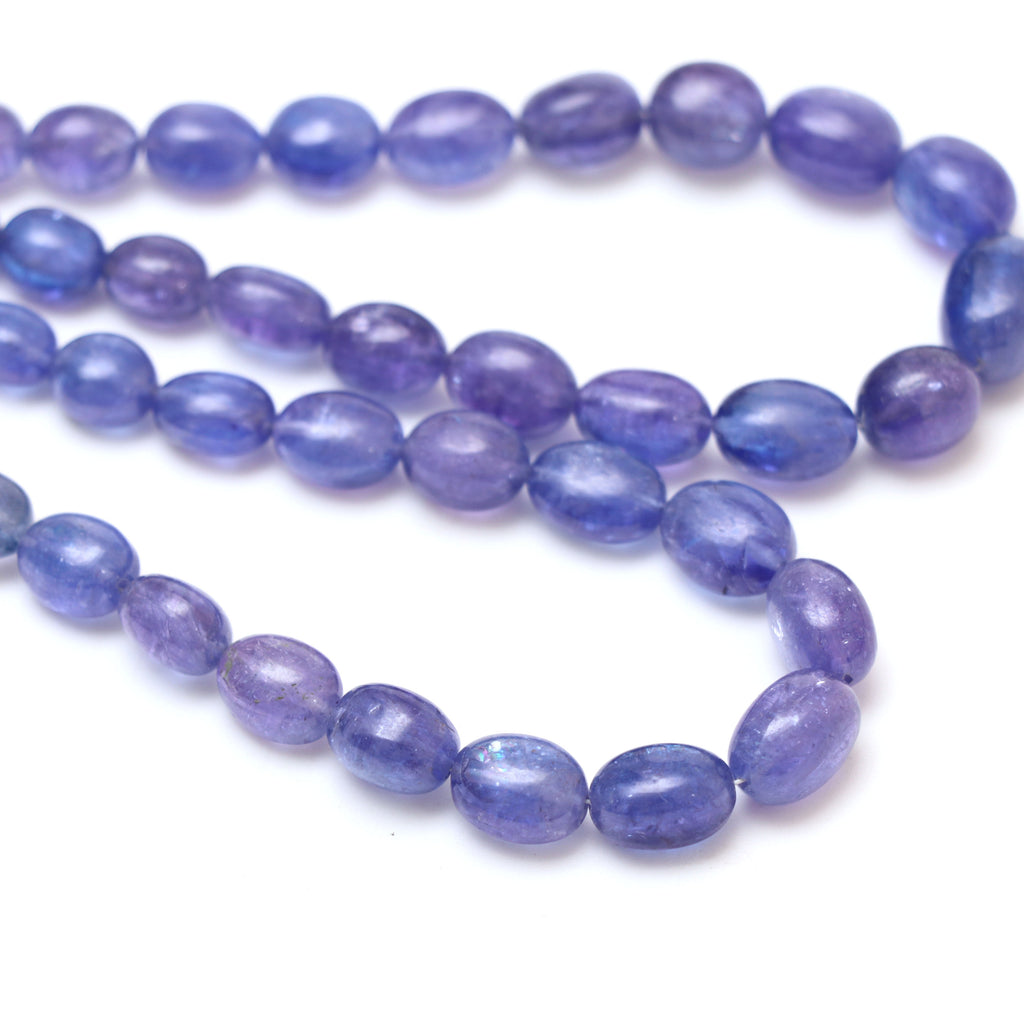 Natural Tanzanite Smooth Tumble Beads | 5x6 mm to 8x11 mm | Tanzanite Tumble Gemstone | 8 Inch/ 18 Inch Full Strand | Price Per Strand - National Facets, Gemstone Manufacturer, Natural Gemstones, Gemstone Beads