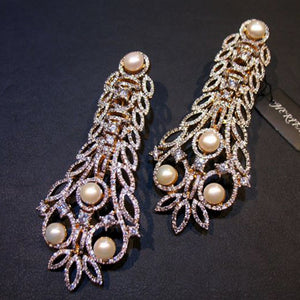 Earings in pearls, zircons-0