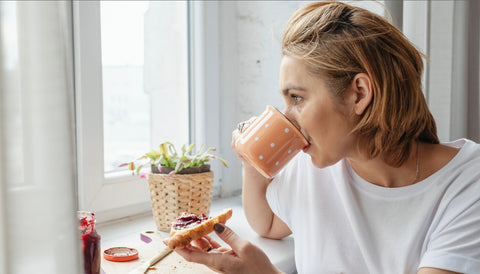 Girl Drinking Coffee with no cell phone