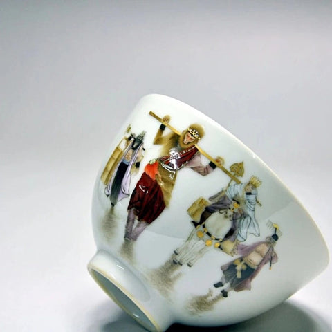 Porcelain teacup with fencai painting of scene from Journey to the West.