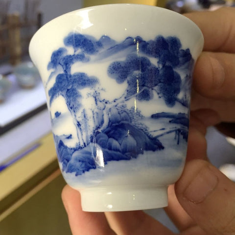Handmade Porcelain Cup with Qinghua (blue) painted motif.