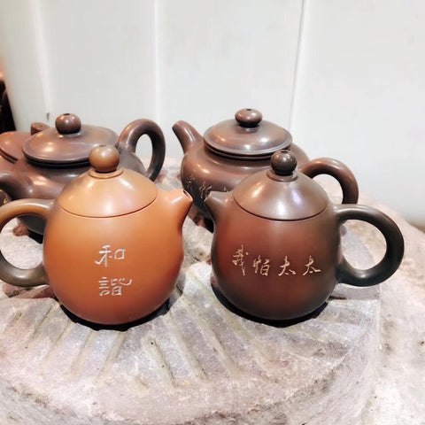 Nixing Teapots displaying their characteristic yaobian.