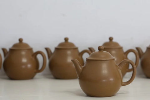 Zhuni Teapots ready for the kiln! Zhuni clay turns from yellow to red when fired.
