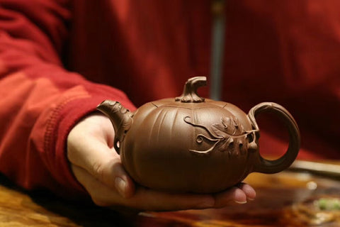 A fully Handmade Yixing Teapot shaped like a pumpkin