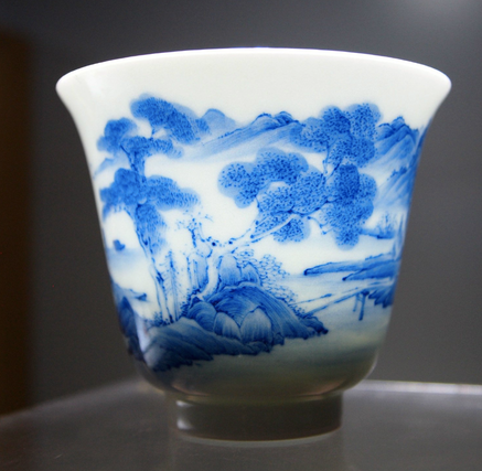 Jingdezhen porcelain with qinghua teacup glowing.