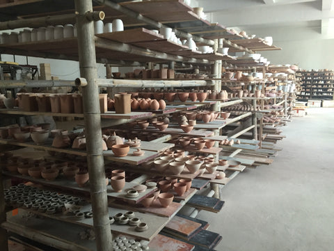 Products are air drying after wheeling and before being polished and covered with the glaze for firing again. This photo gives an idea of the size of Mr. Lee's Studio. Since all the products are handmade and are under strict quality control by Mr.Lee himself, the amount and production rate are limited.