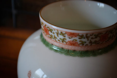 Hand painted fencai motif over white porcelain vase from Jingdezhen