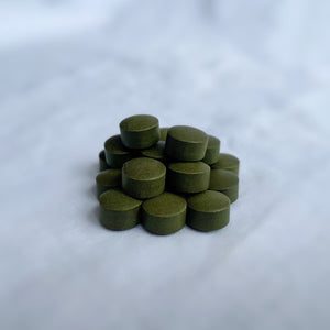 Close up of Fermented Chlorella Tablets